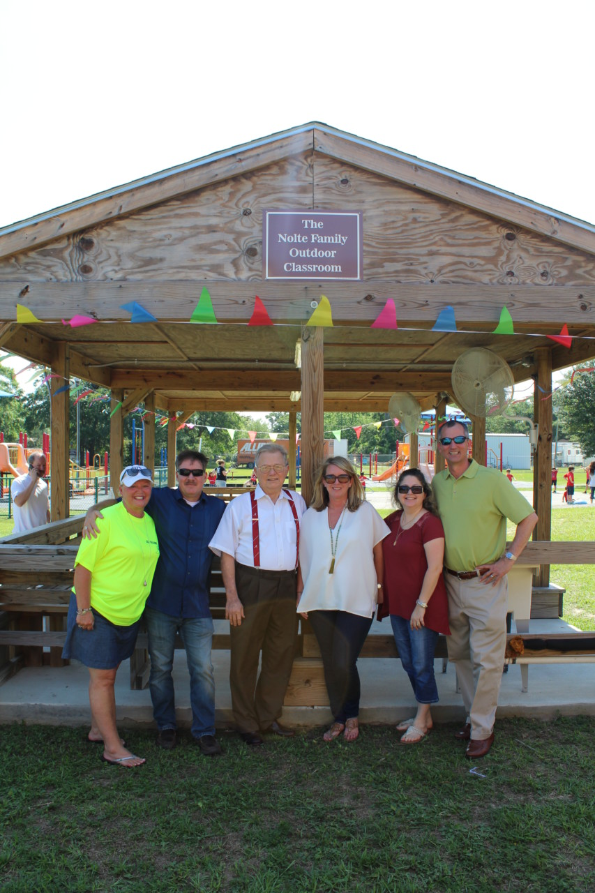 "Cindy Hahn, Preston Gerretse, Greg Nolte Jr., Nicki Nolte, Annette Gerretse, Rob Myers dedicate the new ""Nolte Family Outdoor Classroom""."