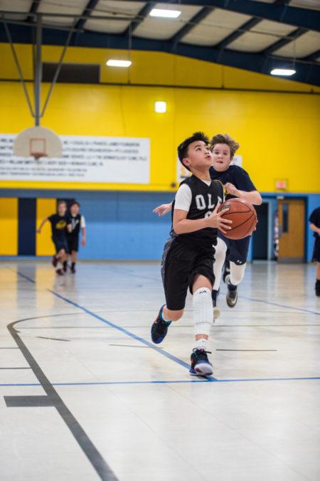 Dylan Nguyen makes the layup versus St. James