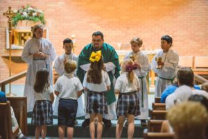 Father Lalo performs grandparents day mass