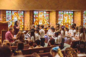 OLF school choir performs for Bishop Kihneman