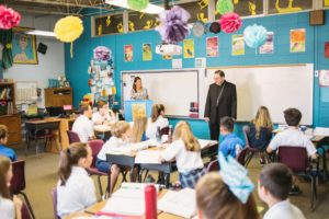 Bishop Kihneman meets with the 6th grade students