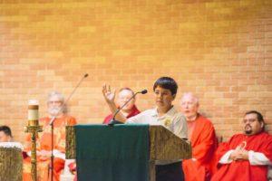 Timothy Walter gives a reading at Bishop Kihneman mass