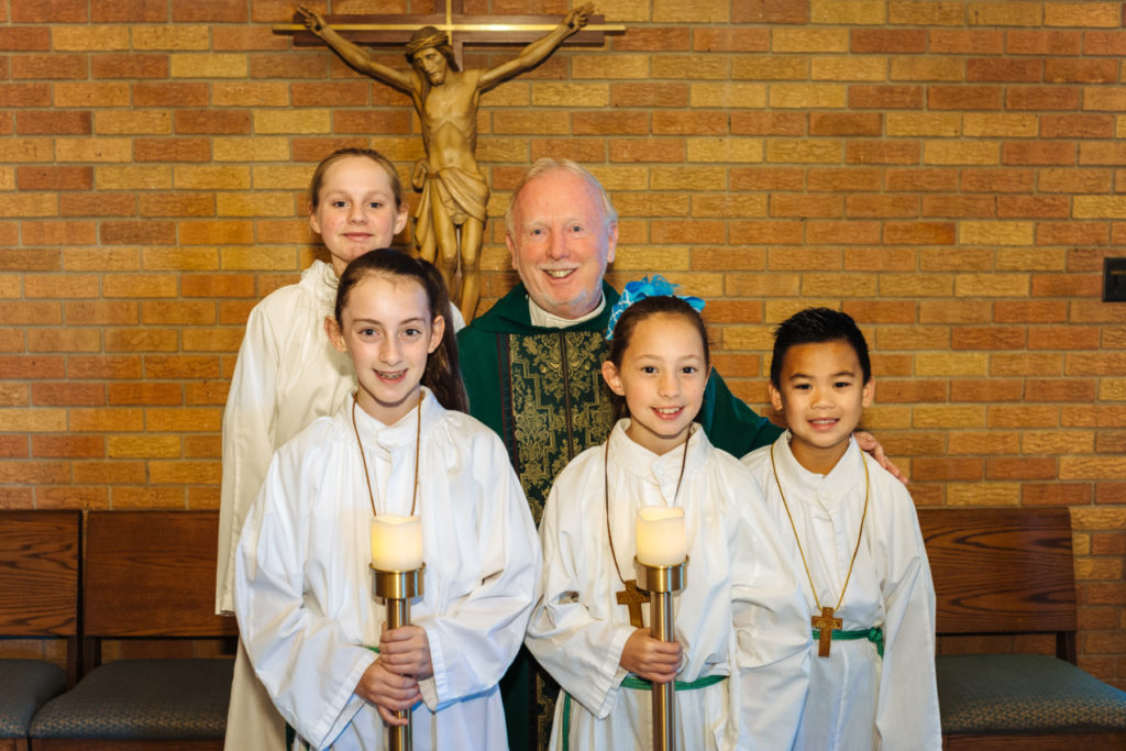 Father Henry and his altar servers