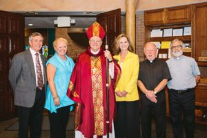 Superintendent Ladner, Principal Hahn, Bishop Kihneman, Asst Superintendant Clark, Father McInerney, Deacon Alexander