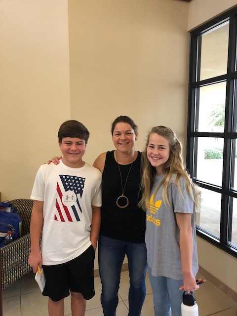 Heith Shinn, Math Teacher Michelle Moak, Zoie Davis at math competition