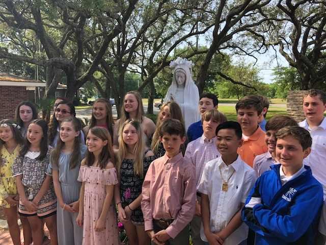 Six graders honor Mary